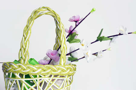 vernal: Detail of a vernal straw handbag with textile flowers isolated on white