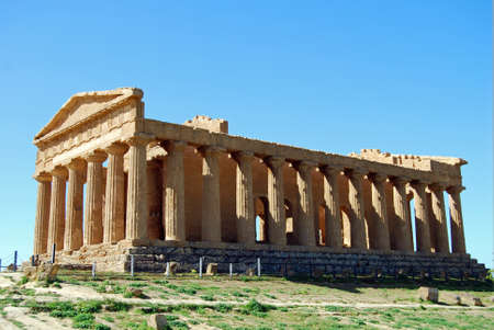 weatherworn: Due to its good state of preservation, the Temple of Concordia,  in the Valley of Temples in Agrigento, is ranked amongst the most notable edifices of the Greek civilization existing today. Stock Photo