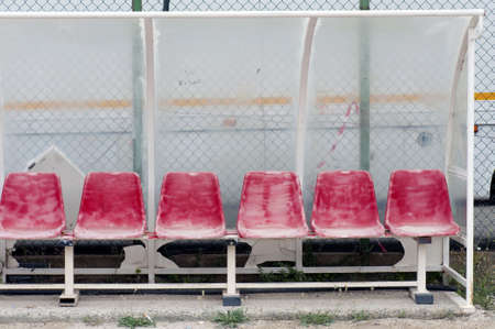 weatherworn: Old and damaged bench on a public football pitch Stock Photo