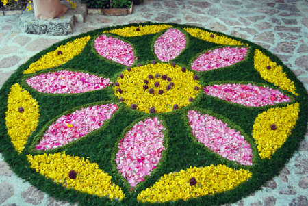spello: Spello, Umbria, Italy - May 2010: Artwork made with different petals on the pavement for the �Infiorata of Spello�. Annual floral decoration contest held in the street on the Sunday after Corpus Domini in Spello, Italy