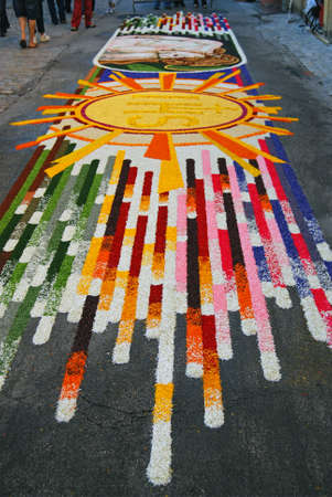 liturgical: Spello, Umbria, Italy - May 2010: Artifact made by fresh petals on the pavement for the floral decorations contest called �Infiorata of Spello�. Annual liturgical event held in the street on the Sunday after Corpus Domini in Spello, Italy Editorial