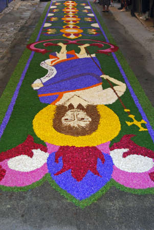liturgical: Spello, Umbria, Italy - May 2010: Liturgical tapestry made by fresh petals on the pavement for the floral decorations contest called �Infiorata of Spello�. Annual event held in the street on the Sunday after Corpus Domini in Spello, Italy Editorial
