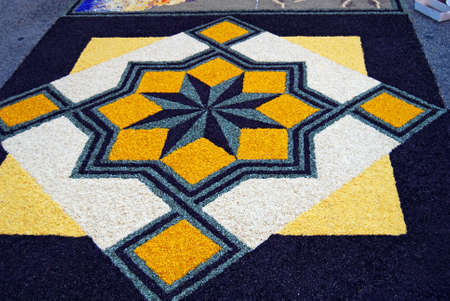 """spello: Spello, Umbria, Italy - May 2010: Wind rose made by fresh petals on the street pavement for the floral decorations contest called """"Infiorata of Spello"""". Annual event held in the street on the Sunday after Corpus Domini in Spello, Italy"""