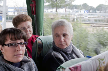Italy - March 2010: Some passengers seated in a chartered bus while travelling during a tour.