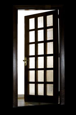 A half-closed wooden door in backlight  photo