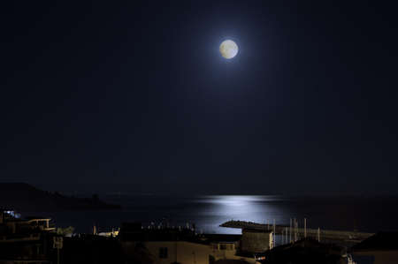 Sea country and ocean by night at moonlight photo