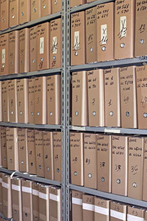 Archive with many folders on a metal shelf Stock Photo - 7632444
