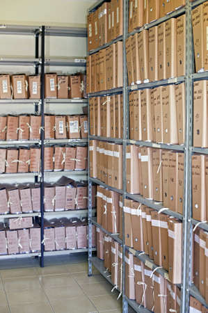 Archive with many folders on a metal shelf Stock Photo - 7632442
