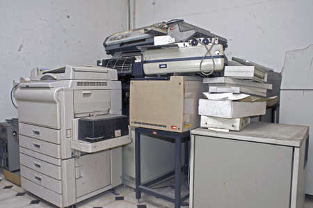 stockroom: Old disused office appliances and equipments piled up in a storeroom