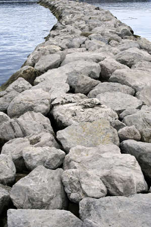 Breakwater stones at the harbour entrance photo