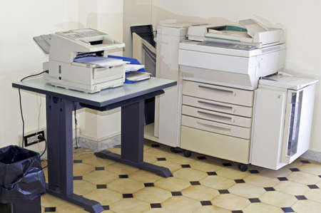 Office room with photocopier and fax machine photo