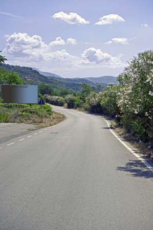 apennines: Country road along Apennines with a billboard, Salerno, Italy