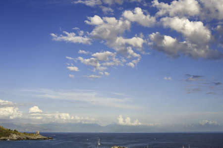 A wide blue sky over the coast with a low horizon