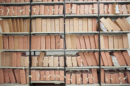 Office archive with many folders on metal shelves Stock Photo - 7928597