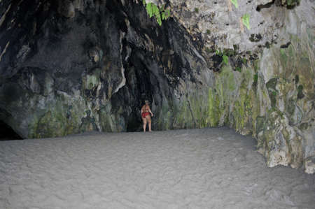 palinuro: Bather visiting a big natural grotto on the beach, Palinuro, Italy