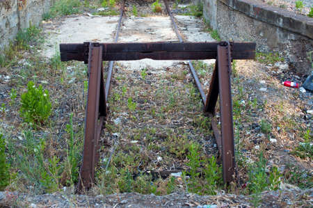 An old abandoned railway line with buffer. Old style photo