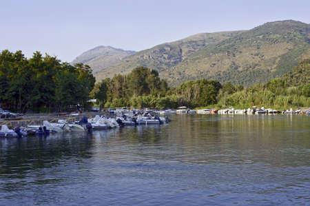 River Mingardo with moored boats, Italy Stock Photo - 8015294