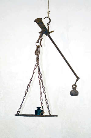An ancient Roman steelyard balance with pad and weights photo