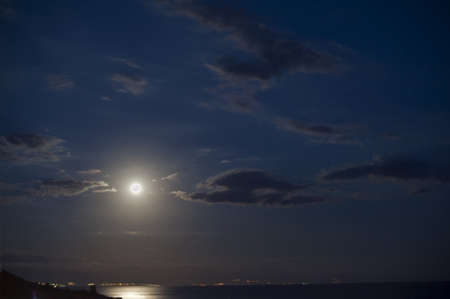 Moonlight over ocean at the skyline  photo