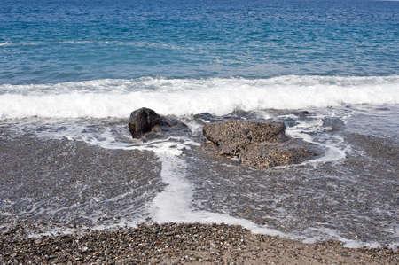 foamy: Foamy waves on the rocky sea foreshore