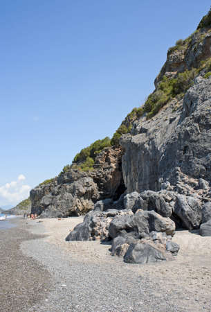 nudism: Charming nudist beach close to a rock spur along Camerota coast, Italy
