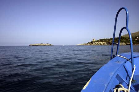 A boat prow heading towards the coast Stock Photo - 8015309