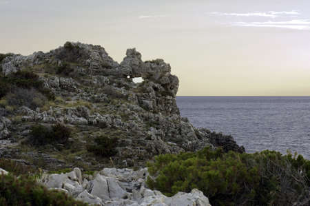Picturesque eroded cliff along the coast, Marina di Camerota, Italy photo