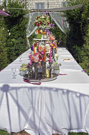Beautiful floral table setting for wedding in a garden photo
