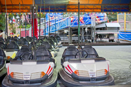 Some olded bumper cars on a Funfair amusement ride photo