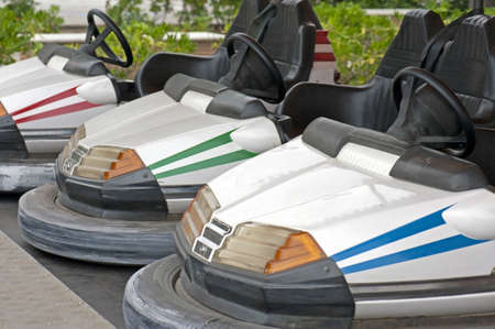 Detail of some old bumper cars on a Funfair amusement ride photo