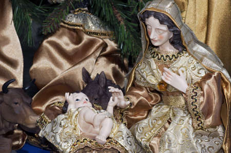 Detail of a Christmas nativity with mother Mary near the infant Jesus photo