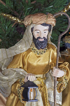 Detail of a Christmas nativity with Joseph near the infant Jesus photo