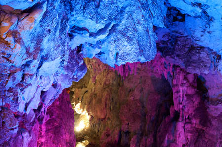 stalagmite: Inside a big coloured cave with stalactite and stalagmite