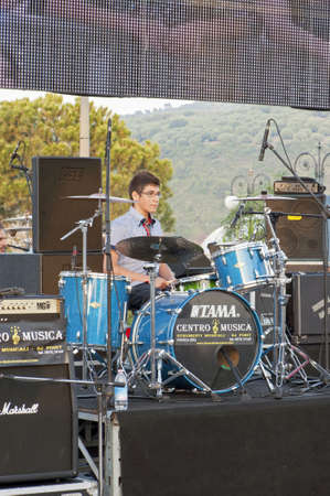 "Marina di Camerota, Salerno, Italy, May 27-28-29, 2011 : ""Meeting del mare"", the annual three days long concert for new emergent groups and singers. Here, just a boy playing drum on the stage."
