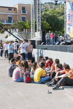 """Marina di Camerota, Salerno, Italy, May 27-28-29, 2011 : """"Meeting del mare"""", the annual three days long concert for new emergent groups and singers. Here, youths waiting for the concert Stock Photo - 9743731"""