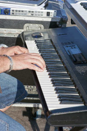 Detail of keyboardist's hands during a concert photo