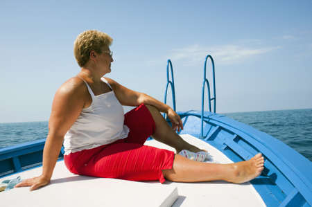 A woman sat on the prow during a boat ride photo