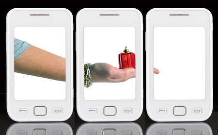 Abstract: three cell phones showing a girl's hand with a bauble as gift Stock Photo - 10543227