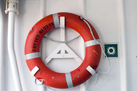 An orange lifebuoy in a gangway  photo