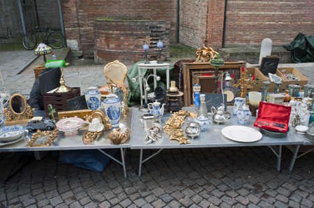 jumble: A stallholder with old artworks  Editorial