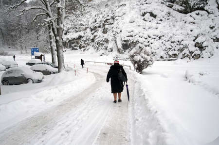 People walking on a mountain road covered with snow  photo