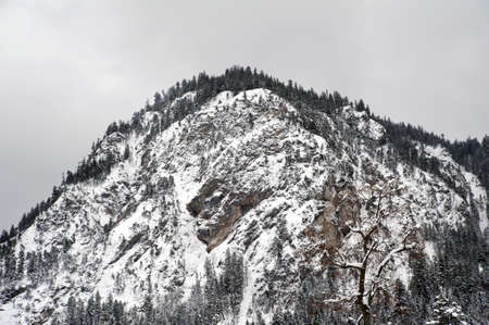 Mountaintop covered with snow photo