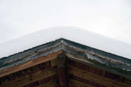Detail of a gable rooftop covered with snow  photo