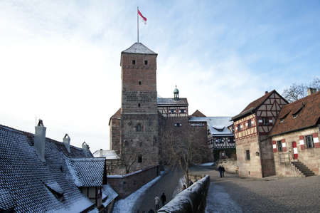 Nuremberg castle  courtyard with Heidenturm  Heathen Tower , Kaiserkapelle  Emperor s Chapel  and Tiefer Brunnen  Deep Well ,Germany Stock Photo - 17401593