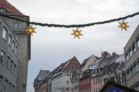 christkindlesmarkt: Stars as Christmas ornament in the street at christkindlmarket, Nuremberg, Germany Stock Photo