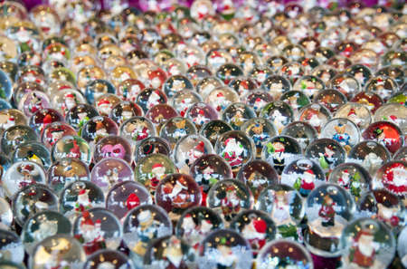 Various Christmas snow globe on a stall photo
