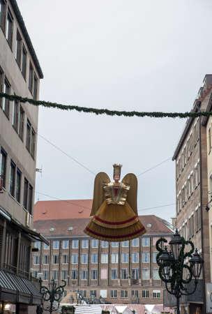 christkindlesmarkt: The typical angel  Rauschgoldengel  in the street at christkindlmarket, Nuremberg, Germany Editorial