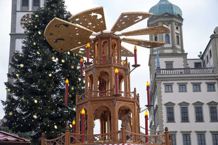 Spinning Christmas Pyramid for Christmas Market in Erfurt with Rathaus  Town hall  in the background, Augsburg  Stock Photo - 18673882