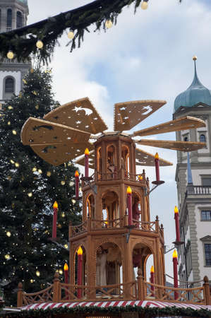 christkindlesmarkt: Spinning Christmas Pyramid for Christmas Market in Erfurt with Rathaus  Town hall  in the background, Augsburg