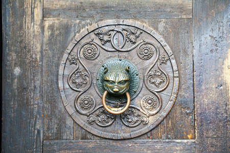 An old bronze door knocker on the Cathedral of Augsburgs door,  Bavaria, Germany photo